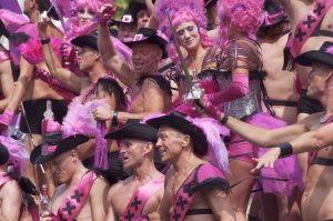 Gay Pride Canal Parade Amsterdam. The purple boys.