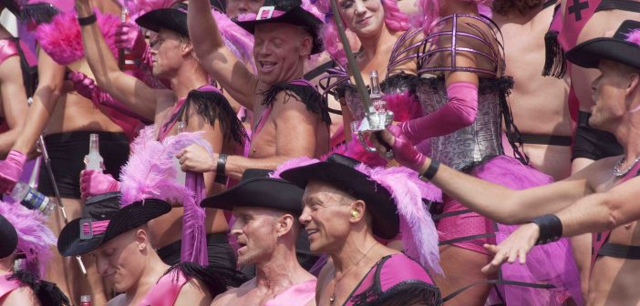 Gay Pride Canal Parade Amsterdam. The purple boys.