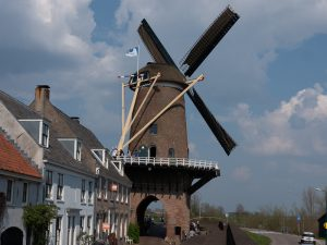 Wijk bij Duurstede Castle: Blues at the River Rhine. Only Winndmill with gate in Holland.