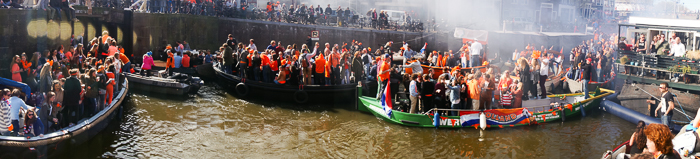 Party boats in a row at the sluice-gate of Noordersluis Amsterdam on King's Day